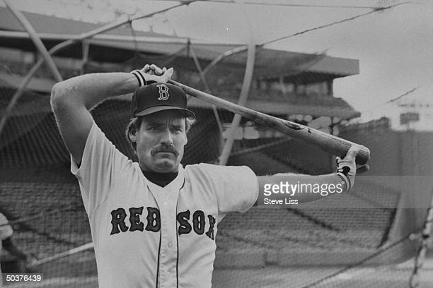 Boston Red Sox thirdbaseman Wade Boggs using baseball bat for leverage as he stretches his upper body in the batting cage during batting practice at...