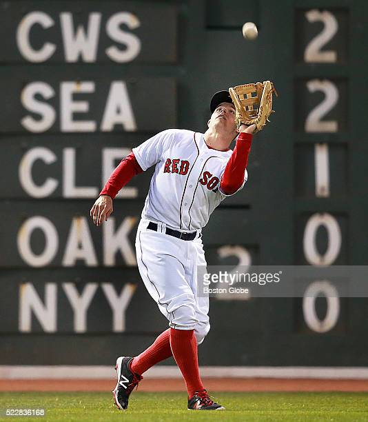 Boston Red Sox utility player Brock Holt catches an fly ball in left field in the second inning during a game agains the Tampa Bay Rays left fielder...