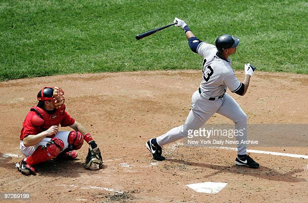 Boston Red Sox's catcher Jason Varitek looks on as New York Yankees' Alex Rodriguez hits a tworun homer to left field in the third inning of game at...