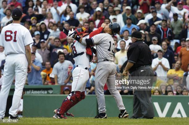 Boston Red Sox's catcher Jason Varitek pushes New York Yankees' Alex Rodriguez in the face as the two fight after Rodriguez was hit by a pitch in the...