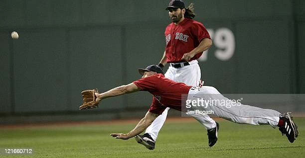 Boston Red Sox's Gabe Kapler, front, dives for a ball hit by the New York Yankees but come up short at Fenway Park in Boston, Sunday, July 25, 2004....