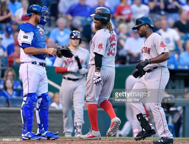 Boston Red Sox's Jackie Bradley Jr scores in front of Kansas City Royals catcher Drew Butera on a tworun home run that also scored Hanley Ramirez in...