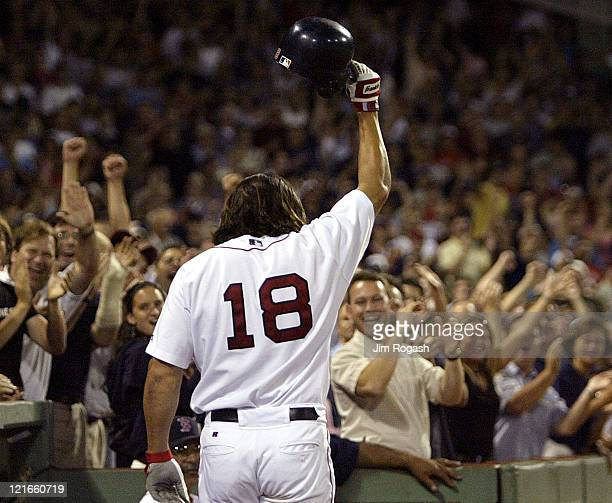 Boston Red Sox's Johnny Damon reacts to the cheers of the crowd after hitting two home runs against the Texas Rangers Friday July 9 2004 The Red Sox...