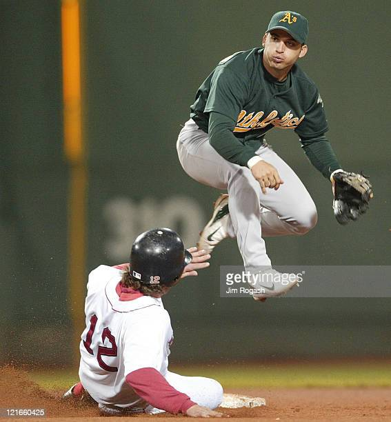 Boston Red Sox's Mark Bellhorn slides after Oakland Athletics second baseman Marco Scutaro turns a double play Thursday May 27 2004 The Red Sox lost...