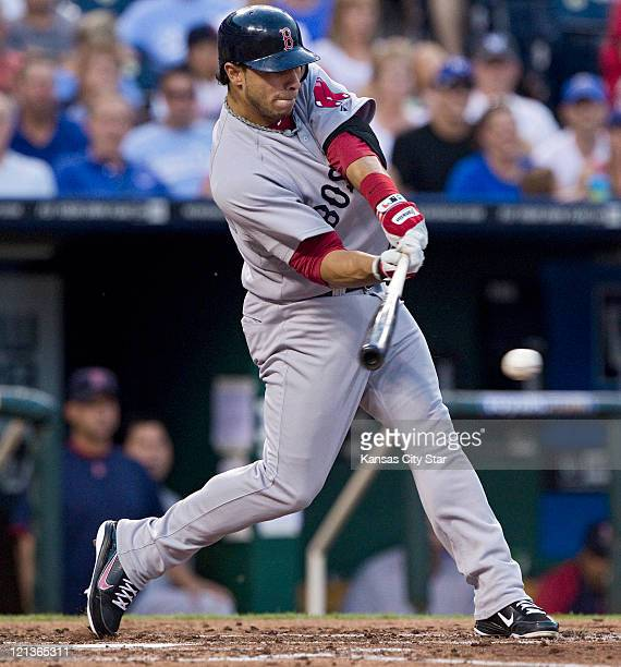 Boston Red Sox's Mike Aviles connects on single in the second inning against the Kansas City Royals at Kauffman Stadium in Kansas City Missouri on...