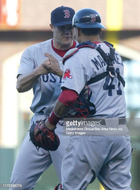 Boston Red Sox's pitcher Jonathan Papelbon and catcher Victor Martinez celebrate their 4-2 win over the San Francisco Giants at AT&T Park in San...