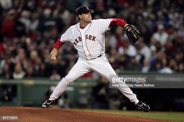 Boston Red Sox's starter Curt Schilling delivers a pitch against the New York Yankees during a game at Fenway Park Schilling was tagged for five runs...