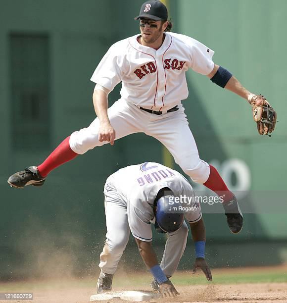 Boston Red Soxsecond baseman Mark Bellhorn leaps over Texas Rangers base runner Eric Young during a doubleplay attempt The Rangers beat the Red Sox...