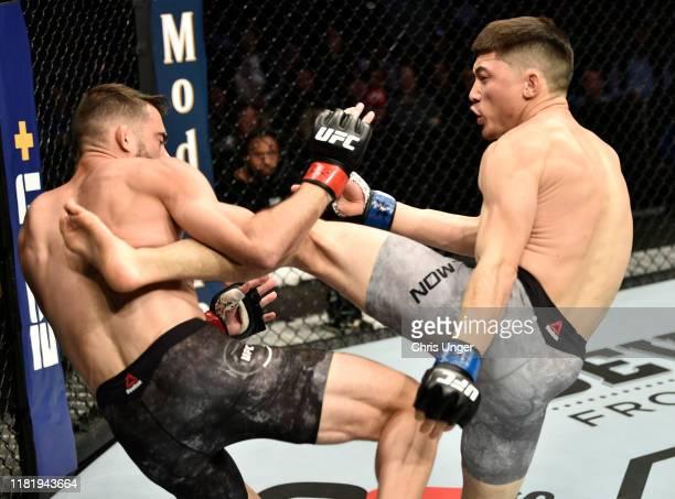 Boston Salmon kicks Randy Costa in their bantamweight bout during the UFC Fight Night event at TD Garden on October 18, 2019 in Boston, Massachusetts.