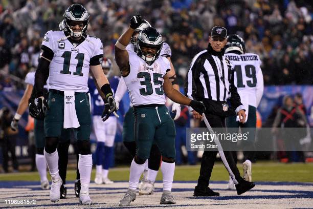 Boston Scott of the Philadelphia Eagles celebrates with his teammates after scoring a touchdown against the New York Giants during the third quarter...