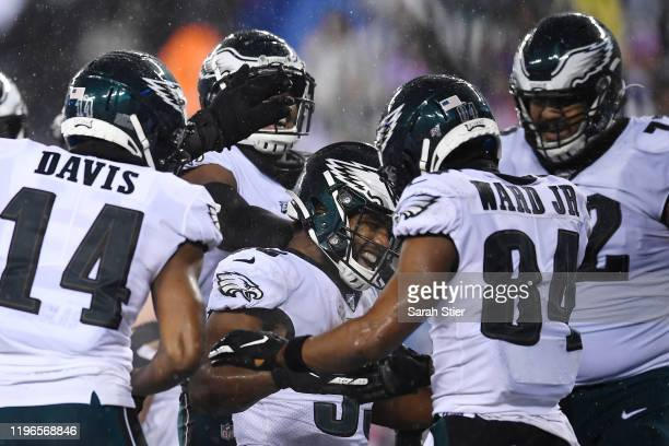 Boston Scott of the Philadelphia Eagles reacts after scoring a touchdown during the second half of the game against the New York Giants at MetLife...