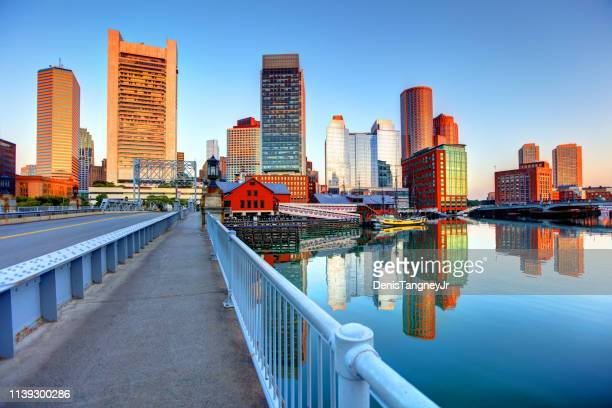 boston skyline along fort point - massachusetts stock pictures, royalty-free photos & images