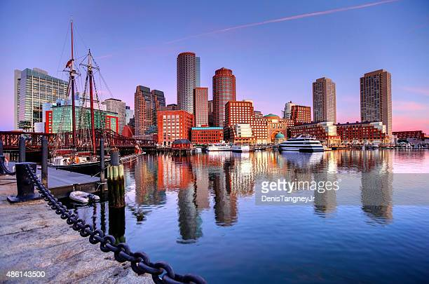 boston skyline along the harborwalk - massachusetts stock pictures, royalty-free photos & images