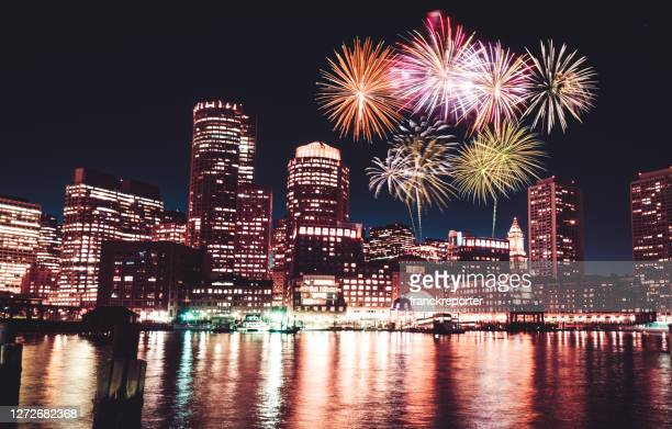 boston skyline at night with fireworks - boston massachusetts stock pictures, royalty-free photos & images
