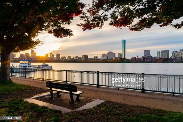 boston skyline at sunrise with boats and harbor - promenade stock pictures, royalty-free photos & images