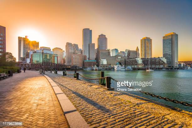 boston skyline at the sunset - boston stock pictures, royalty-free photos & images