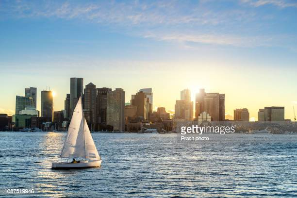 boston skyline seen during sunset from piers park, massachusetts, usa. - boston stock pictures, royalty-free photos & images