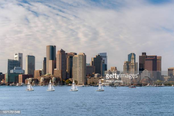 boston skyline with sail boat in massachusetts, usa. - boston stock pictures, royalty-free photos & images