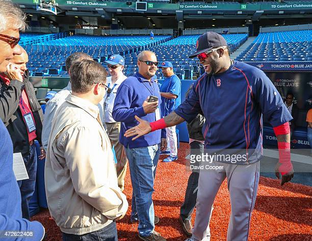 Boston Slugger David Ortiz signs autographs and chats with the fans during batting practice before the game between the Toronto Blue Jays and the...