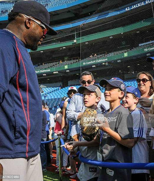 TORONTO ON MAY 8 Boston Slugger David Ortiz signs autographs and chats with the fans during batting practice before the game between the Toronto Blue...