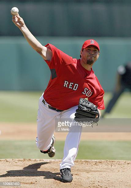 Boston starting pitcher Josh Beckett makes a pitch during Sunday's action against Florida at City of Palms Park in Ft. Myers, Florida on March 25,...