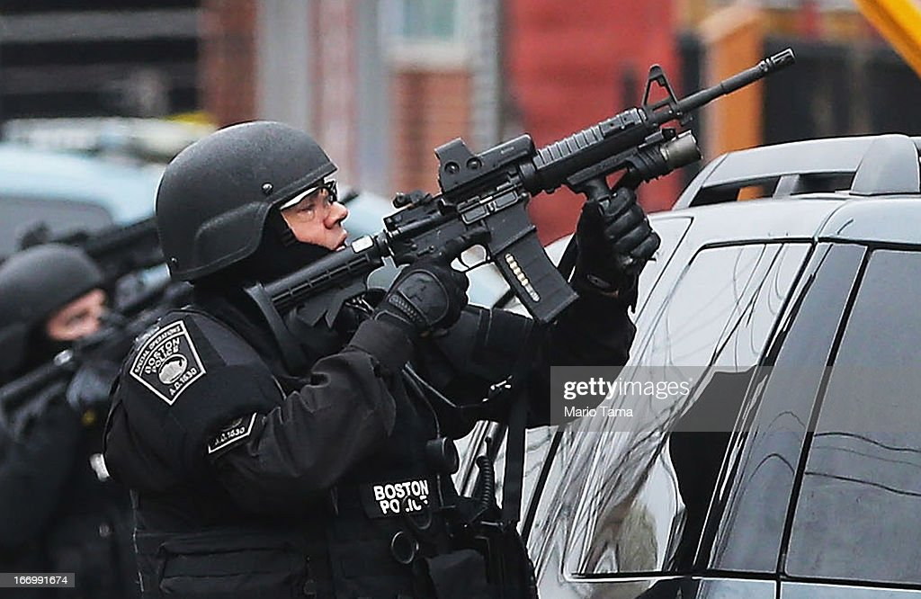 A Boston Swat Team Member Takes Up As Posistion As They Search For