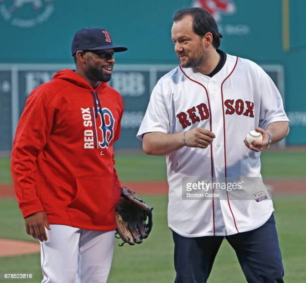 Boston Symphony Orchestra music director Andris Nelsons right is pictured with Red Sox outfielder Jackie Bradley Jr left after Bradley tried to catch...