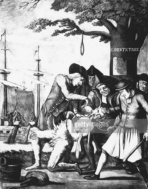 Boston Tea Party 16 December 1773 Bostonians tarring and feathering the Excise man and forcing tea down his throat In background tea is being dumped...