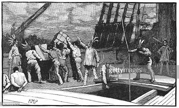 Boston Tea Party 26 December 1773 Inhabitants of Boston Massachusetts dressed as American Indians  throwing tea from vessels in the harbour into the...