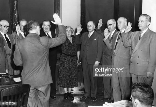 Boston teachers and school department personnel take an antiCommunist oath in Boston April 13 1953