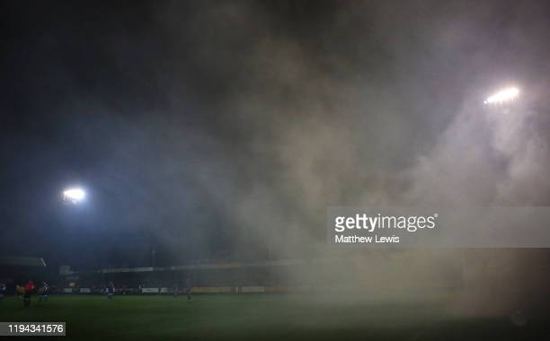 Boston United fans through flares onto the pitch, after they scored during the FA Cup Second Round Replay match between Boston United and Rochdale at...