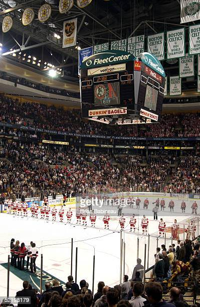 Boston University and Northeastern University line up during the National Anthem at the 2005 Beanpot Tournament on February 14, 2005 in Boston,...
