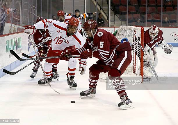 Boston University forward Jordan Greenway has the puck knocked off his stick by UMass Amherst defenseman Callum Fryer during first period action of...