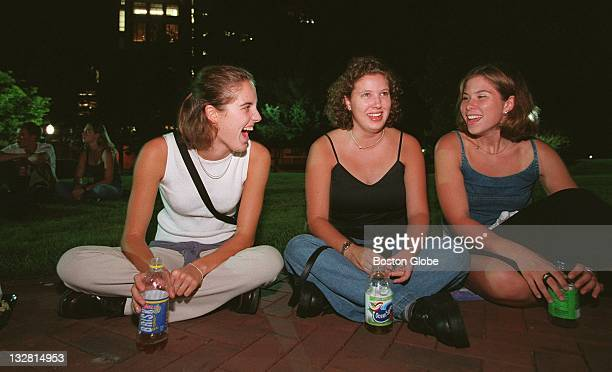 Boston University freshmen Beth Hullmuth left Darcy Lurix center and Jacqueline Clark right enjoy nonalchoholic beverages as they await the start of...