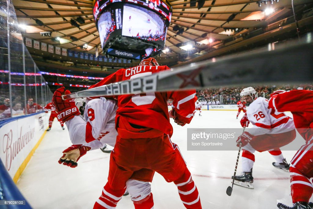 Boston University Terriers defenseman Cam Crotty (5) battles with Cornell Big Red forward Noah Bauld (9) during the Red Hot College Hockey Game between the Boston University Terriers and the Cornell Big Red on November 25, 2017, at Madison Square Garden in New York, NY.