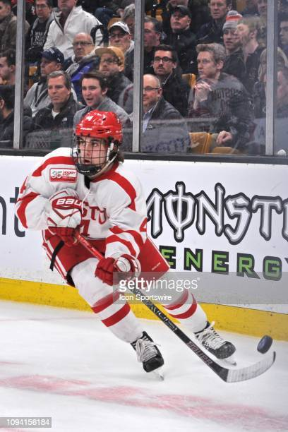 Boston University Terriers defenseman David Farrance passes the puck hard out of his zone. During the Boston University Terriers game against the...
