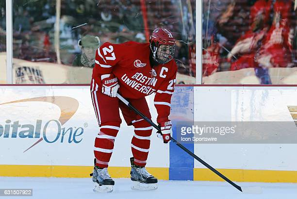 Boston University Terriers defenseman Doyle Somerby gets set for an offensive zone face off during a Frozen Fenway NCAA Men's Division 1 hockey game...