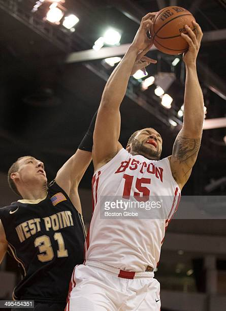 Boston University Terriers Dom Morris pulls down a rebound over Army Black Knights Kevin Ferguson during second half action of the Patriot League...