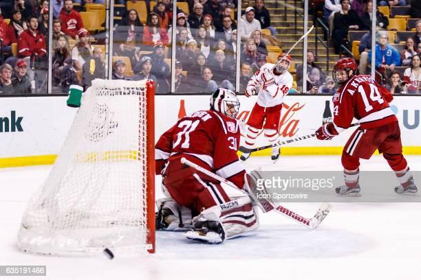 Boston University Terriers forward Clayton Keller watches his shot go wide of the goal, blocked by Harvard University Crimson goaltender Merrick...