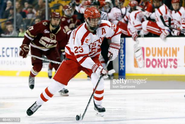 Boston University Terriers forward Jakob Forsbacka Karlsson carries the puck over the blue line during a Hockey East semifinal between the Boston...