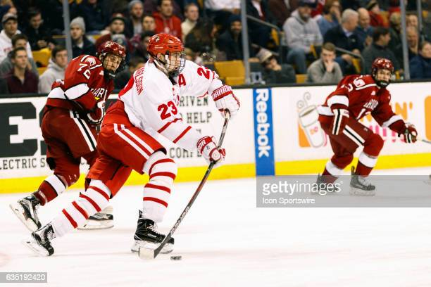 Boston University Terriers forward Jakob Forsbacka Karlsson clears the puck from Terrier ice during the second period of the Beanpot Tournament...