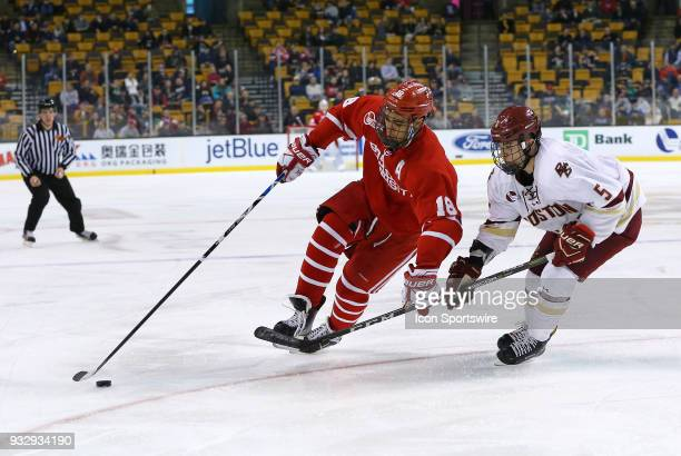Boston University Terriers forward Jordan Greenway and Boston College Eagles defenseman Casey Fitzgerald in action during a college hockey game...