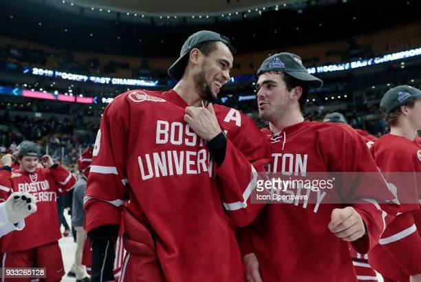 Boston University Terriers forward Jordan Greenway and Boston University Terriers defenseman Dante Fabbro chat after the Hockey East championship...