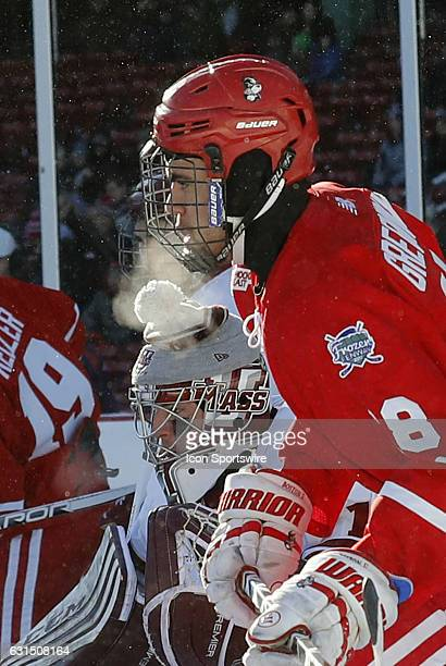 Boston University Terriers forward Jordan Greenway sets up to the side of UMass Minutemen goaltender Ryan Wischow on the power play during a Frozen...