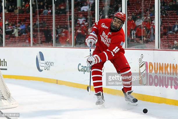 Boston University Terriers forward Jordan Greenway tries to control the puck during a Frozen Fenway NCAA Men's Division 1 hockey game between the...