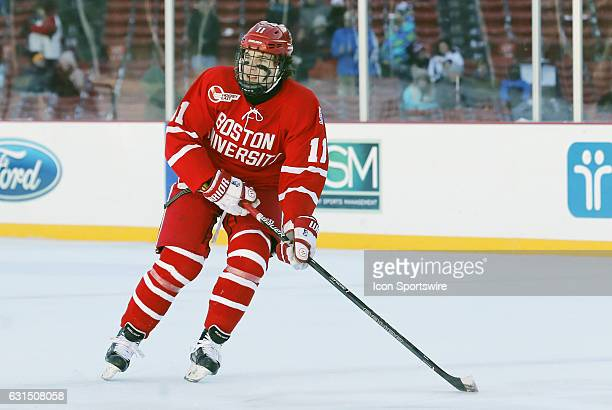 Boston University Terriers forward Patrick Curry during a Frozen Fenway NCAA Men's Division 1 hockey game between the Boston University Terriers and...