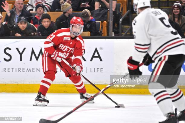 Boston University Terriers forward Patrick Harper tries to get past Northeastern Huskies defenseman Ryan Shea with the puck. During the Boston...