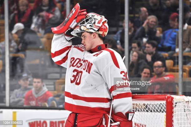 Boston University Terriers goaltender Jake Oettinger puts his mask back on and gets ready for the 3rd period. During the Boston University Terriers...