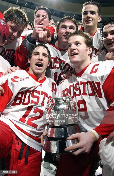 Boston University Terriers players celebrate their victory against the Northeastern Huskies during the 2005 Beanpot Tournament at the Fleet Center in...