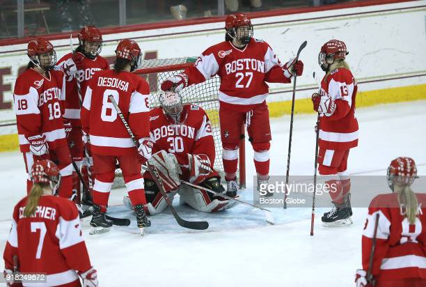 Boston University Terriers teammates console goalie Corinne Schroeder after the team lost 43 to Boston College during the overtime period Boston...